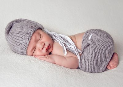 First and Forever Photography, Iveta Dietz, photography by Iveta Dietz, baby feet, gray shorts, gray hat, side shot, back wrinkles, gray outfit, dreaming, gray hat, newborn, baby, baby boy, infant, best newborn photographer, best baby photographer, best St. Charles photographer, St. Louis photographer, posed baby, sleeping baby, swaddled baby, wrapped baby, baby's first year, safe posing, safety first, comfortable posing, cute baby, happy baby, sleepy baby,