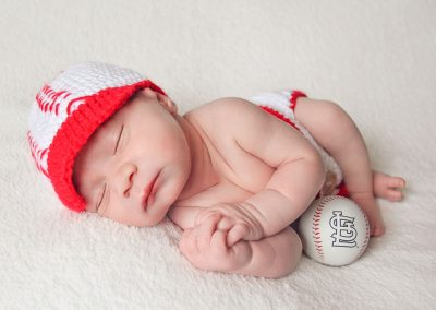 First and Forever Photography, Iveta Dietz, photography by Iveta Dietz, baseball, baseball outfit, baseball fan, red hat, St. Louis Cardinals, basket, young Cardinals fan, newborn, baby, baby boy, infant, best newborn photographer, best baby photographer, best St. Charles photographer, St. Louis photographer, posed baby, sleeping baby, swaddled baby, wrapped baby, baby's first year, safe posing, safety first, comfortable posing, cute baby, happy baby, sleepy baby,